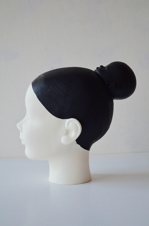 This sculpture is an homage to the Indonesian women (my ancestress). These women always use their hair in a bun. I use the colour black (no colour) and white (all the colours). Black and white is an important issue in my work, as me, always balancing between extremes. The bun is here an other face. Symbolic also me. Living in two cultures. Always looking for balance. Who am I ?